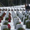A couple walks among the graves during the Wreaths Across America Ceremony at the Massachusetts Veteran's Memorial Cemetery in Winchendon SENTINEL&ENTERPRISE/ Jim Marabello
