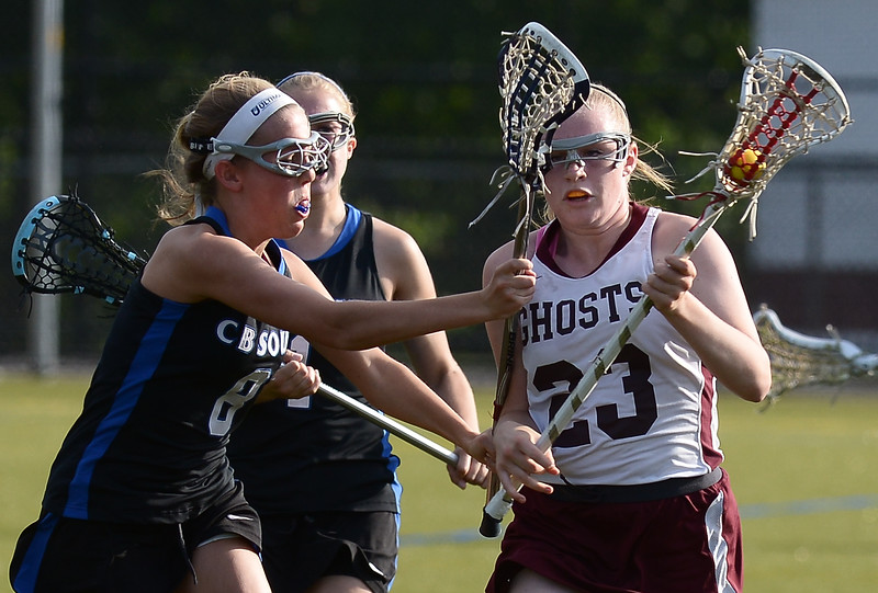 Bob Raines--Montgomery Media / Abington's Sam McGee gets a cross check from Central Bucks South's Kelly Senour May 12, 2015.