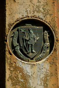 Commonwealth of Mass. symbol on a sign