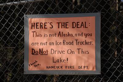 Sign at the Nubanusit Lake boat landing in the winter of 2011-2012. Hancock, NH