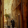 French couple in ancient street.