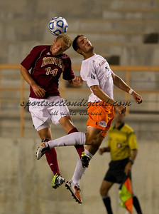 Zach Bolden (14) heads the ball while being contested by Nick Posthuma (7).  Cal State Fullerton beat Denver University 4-2 at Titan Stadium, Fullerton.