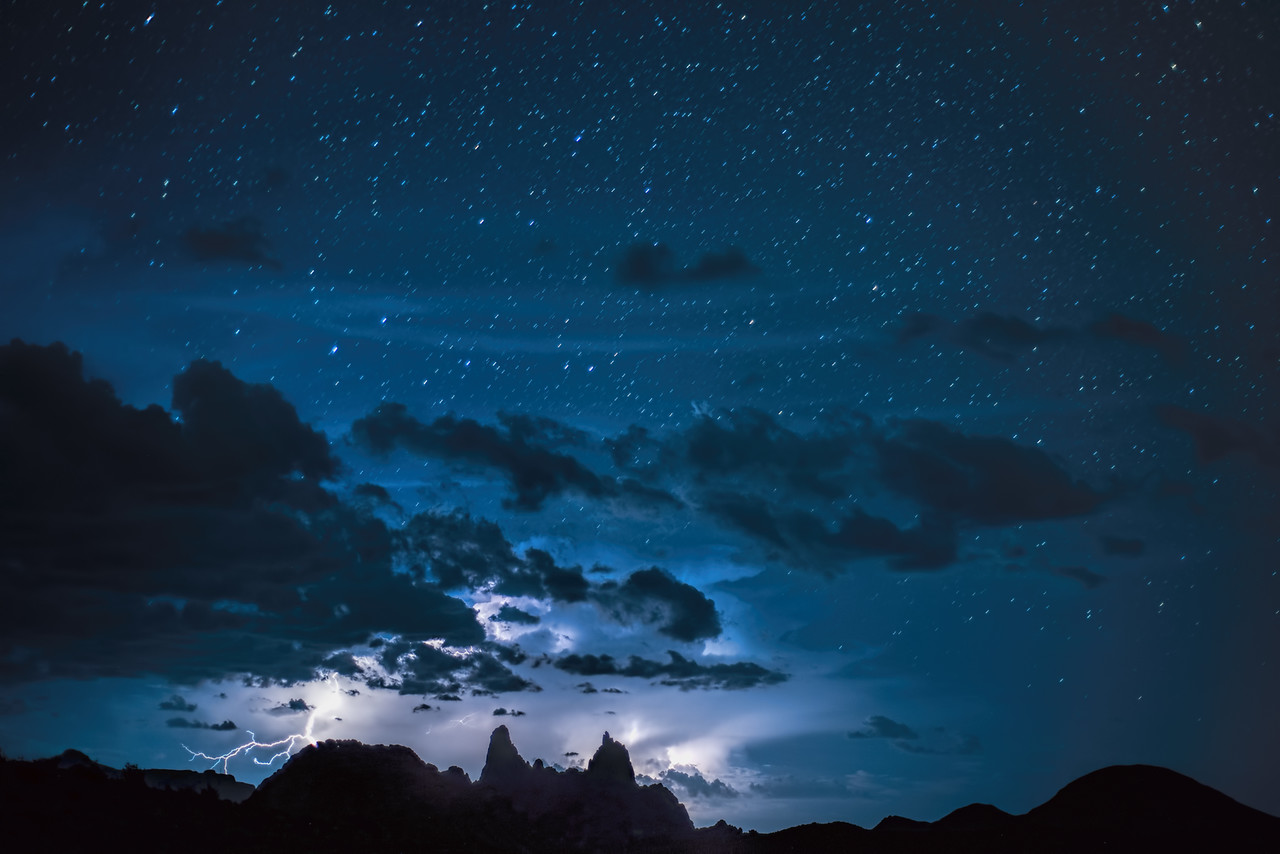 Lightning and stars over Mule Ears, Big Bend National Park