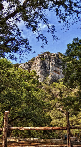 The towering Seven Bluff at the Third Crossing of the Frio River in Concan, TX