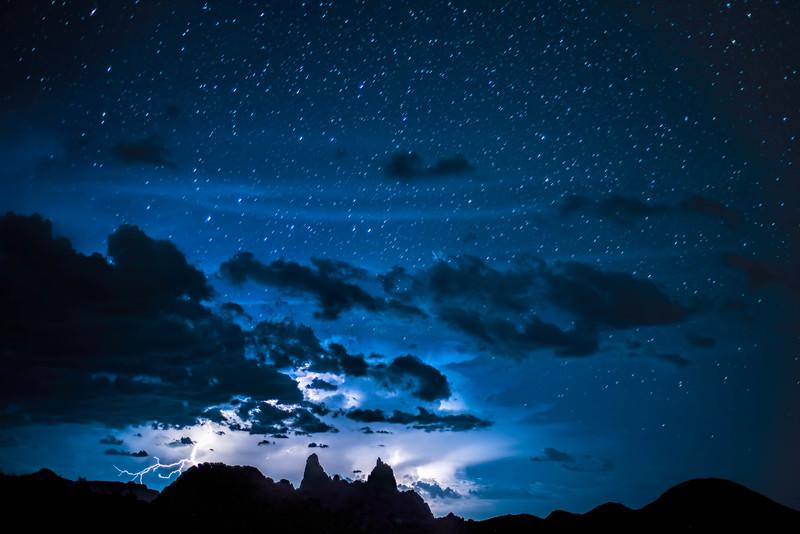 Lightning and stars over Mule Ears, Big Bend National Park