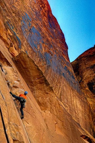 Rock climber on Potash Road near Moab