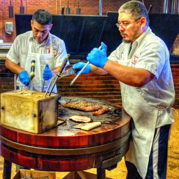 The carvers at Kreuz Market, Lockhart