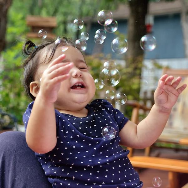 Mila loves bubbles!