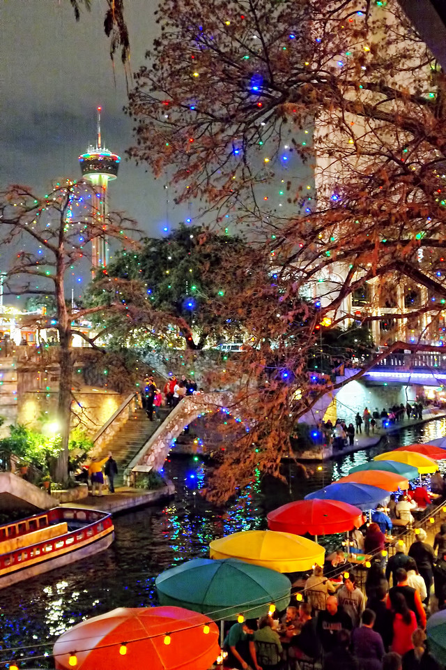 Hemisfair Tower in the background, Casa Rio tables on the Riverwalk