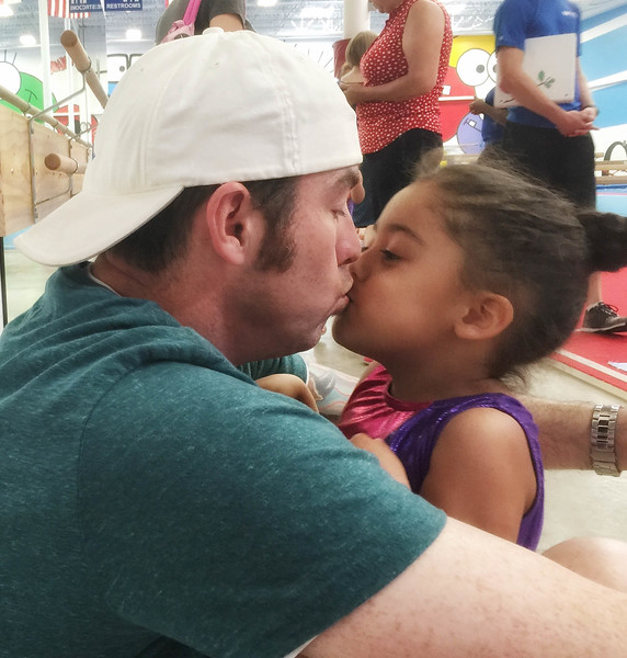 A kiss for Daddy after a great morning at gym