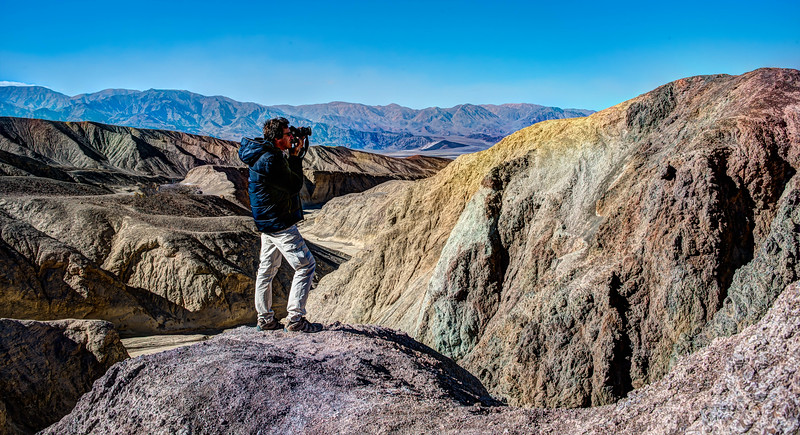 A hiker framing his shot in Artists' Palette