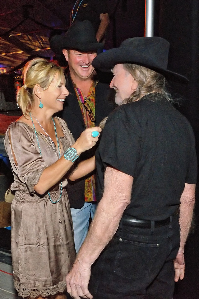 Tracy and Jim Hartman, owners of Rio Brazos Texas Music Hall, welcome Willie Nelson to their Grand Opening