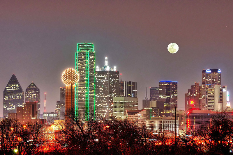 Dallas skyline with full moon rising