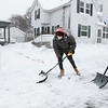 Nong thao, 32, and Anthony Iagallo, 28 in red hood, finish up shoveling their driveway on Spruce Street in Leominster Thursday afternoon. SENTINEL & ENTERPRISE/JOHN LOVE