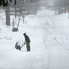 A resident plows his driveway on Arlington Street in Leominster Thursday afternoon. SENTINEL & ENTERPRISE/JOHN LOVE