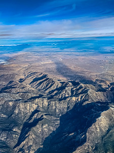 Snow arts; aerial view of snow covered mountains in California.