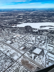 Snow arts; aerial view of snow covered city in winter. Roads and interchange and streets are outlined by snow creating an intricate pattern.