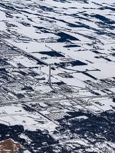Snow arts; aerial photo city blanketed with snow in winter showing intricate pattern of city roads and streets and city blocks.