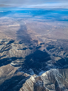 Snow arts; aerial view of snow covered mountains in California