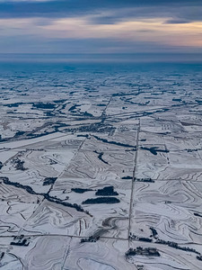 Snow arts; aerial view snow covered farmlands with intricate patterns of farm outlines