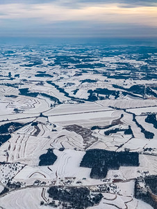 Snow arts; farmlands covered with snow in winter with intricate pattern of farm outlines