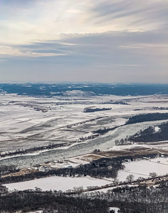 Snow arts, Aerial view of Ice plates on the surface of frozen Missouri River in winter with snow covered fields around the river