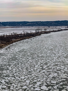 Snow arts, Aerial view close up of Ice plates on the surface of frozen Missouri River in winter