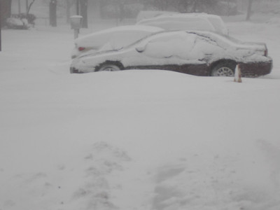 The plow driver pushes the snow from the entrance of 13th avenue