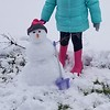 Emma Harshman, age 6, Altamont, makes a mini snowman.<br /> Submitted by Monica Harshman