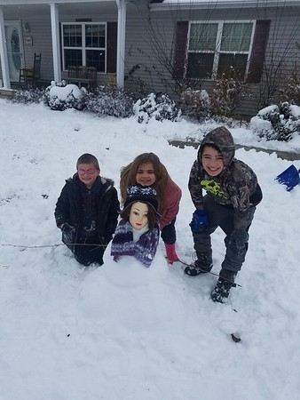 Micaiah, Maleah and Malik Coy make a Snow-woman in Neoga.<br /> Submitted by Megan Coy