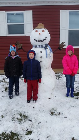 Meet the newest member of our family, Snowseph Davis.<br /> Photo taken in Louisville. Pictured are Khloe, Crawford & Kylee Davis.<br /> Submitted by Courtney Davis