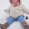 Zayda Moseley, 9 months old, enjoying her first snow experience. She didn't know what to think of it!<br /> <br /> Submitted by mom Brandi Smithson