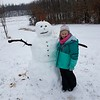 Karly Zumwalt is having fun sledding and building snowman Smiley in Altamont.<br /> Submitted by Jeanna Brummer