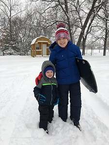 Lincoln, age 10, and Myles Ervin, age 3, getting ready to sled at Community Park. This is Myles first time playing in the snow and sledding. Submitted by Nancy Ervin
