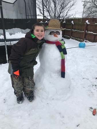 Devin Grubb with snowman.<br /> <br /> Submitted by Dawn Grubb