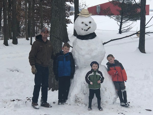 The Wilhour boys spent about an hour with their Dad building a giant snowman north of St. Elmo. Pictured are Blaine Wilhour and sons Nolan, Jonah and Raylan.<br /> Submitted by Amber Wilhour
