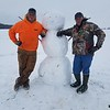 Snowman with snow buddies Brad Ruholl and Chris Ruholl in Toledo.<br /> <br /> Submitted by Carrie Ruholl