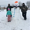 "Matthew and Marcus helped little sister Mackynzie make a snowman at Lake Sara! She said it was ""snow much fun!""<br /> <br /> Submitted by Natasha Hites"
