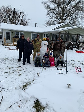 A few Brownstown fireman & the Rural Med EMS crew that were staged at the firehouse due to the storm help Brownstown resident Tresten Wall & family build a fireman snowman this morning. Tresten became a special part of our fire family as he began his cancer journey 1 1/2 years ago. As you can tell he is doing great & is cancer free!!