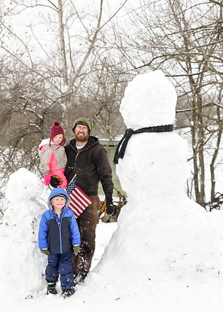 Shown is an over 8-foot-tall snowman in Green Creek with Aaron Mette, Oliver Mette (4) and Emery Mette (2).<br />  Photo by Mom: Krista Mette