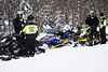 HOLLY PELCZYNSKI - BENNINGTON BANNER Kyle and Chris Case, of Colebrook CT  stop for a routine check of insurance and registration by Bennington Police Chief, Pau Doucette on Friday morning in Woodford VT.  Doucette and others on the Snow Mobile Task force has increased patrols in Woodford after in influx of 3-4 feet of snow dropped in Woodford after the recent Nor'Easter.