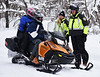 HOLLY PELCZYNSKI - BENNINGTON BANNERRay and Jen Bandwater, of Cambridge NY, stop for a check of insurance and registration by  Bennington Police Detective Larry Cole and officer Amanda Knox on Friday morning in Woodford VT. Members of the department on the Snow Mobile Task force has increased patrols in Woodford after in influx of 3-4 feet of snow dropped in Woodford after the recent Nor'Easter.