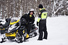 HOLLY PELCZYNSKI - BENNINGTON BANNER Christopher Case of Colebrook CT stops for a check of insurance and registration by Bennington Police officer, Amanda Knox on Friday morning in Woodford VT. Knox, and others on the Snow Mobile Task force has increased patrols in Woodford after in influx of 3-4 feet of snow dropped in Woodford after the recent Nor'Easter.