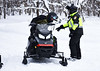 HOLLY PELCZYNSKI - BENNINGTON BANNER Matt Paulsen, of New Haven CT stops for a check of insurance and registration by Bennington Police Chief, Pau Doucette on Friday morning in Woodford VT.  Doucette and others on the Snow Mobile Task force has increased patrols in Woodford after in influx of 3-4 feet of snow dropped in Woodford after the recent Nor'Easter.