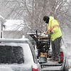 BEN GARVER — THE BERKSHIRE EAGLE<br /> Contractor Larry Stevens gets his truck ready to tackle even more snow in Pittsfield, Wednesday, March 14, 2018.