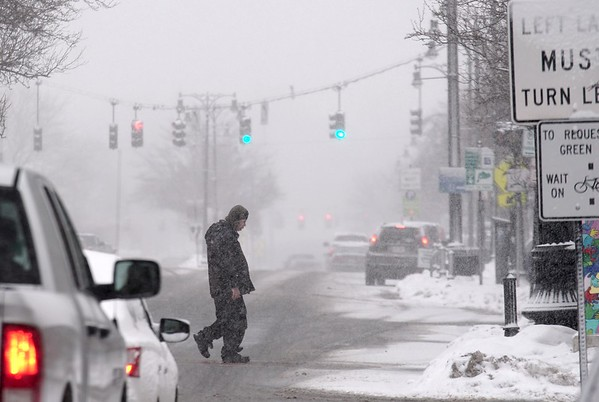 BEN GARVER — THE BERKSHIRE EAGLE<br /> A man crosses north Street in Pittsfield.Overnight snow marks the beginning of snow showers that could accumulate from 6-12 inches.