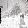 BEN GARVER — THE BERKSHIRE EAGLE<br /> A copuple takes a stroll on  Main Street in Lenox, Mass., Wednesday, March 14, 2018. Heavy snows linger in New England.