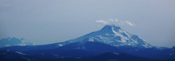 Mt. Jefferson on right and the Three Sisters on left.