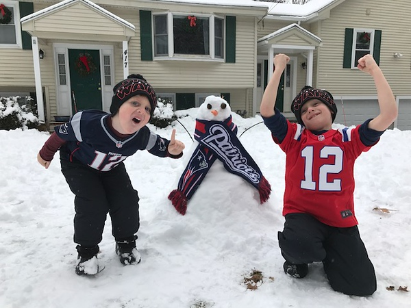 . Andrew (6) and Owen St.Germain (4) in Tewksbury enjoyed today\'s snow day as they prepare to watch their favorite Patriots in the AFC championship game this weekend.  Go Patriots!