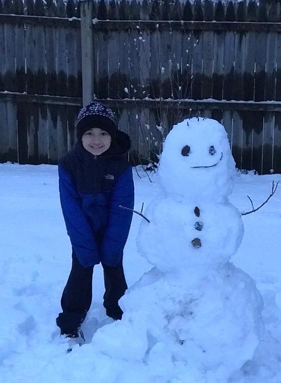 . Kham Chanthavongsack 8yrs old and his Snowman.